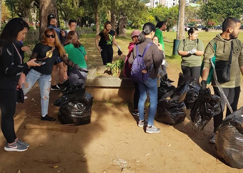 BAGUIO. The Baguio City Government continues to gain support from the private sector in its cleanliness program. Since June, a number of organizations mounted their clean-up drives in parks, waterways and other areas like this group of employees from the IHG company. (Contributed photo)