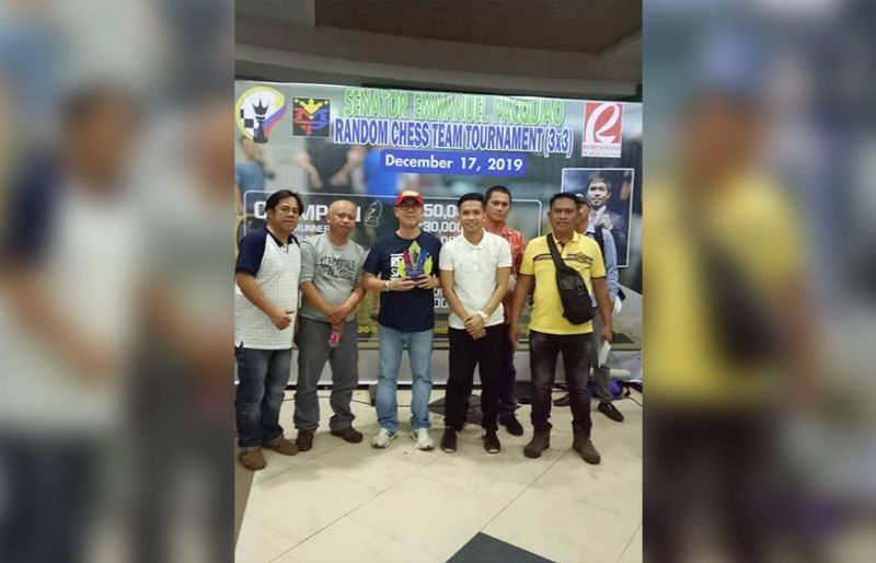 GENERAL SANTOS. Guevarra Law Office team manager lawyer Jong Guevarra, third from left, receives the third place trophy, of the Senator Emmanuel D. Pacquiao's birthday random chess team tournament held at the Robinson's Place General Santos on December 17. (Contributed photo)