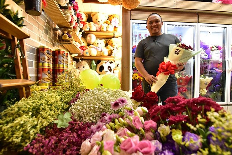 DAVAO. Peter Naurice Pegarro is a registered nurse but chose to pursue his passion in floristry and decided to run a business with his wife. (Photo by Macky Lim)