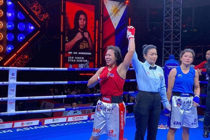 AND THE WINNER IS. Nice Zzaa Petecio of the Philippines, left, reacts after the referee raises her hand following a unanimous decision victory over Minu Gu Rung of Nepal in their Grand Slam Asian Boxing Championship 2019 women 57-kilogram gold medal bout Saturday, December 21, in Xiamen, China. (Nicezzaa Petecio Facebook)