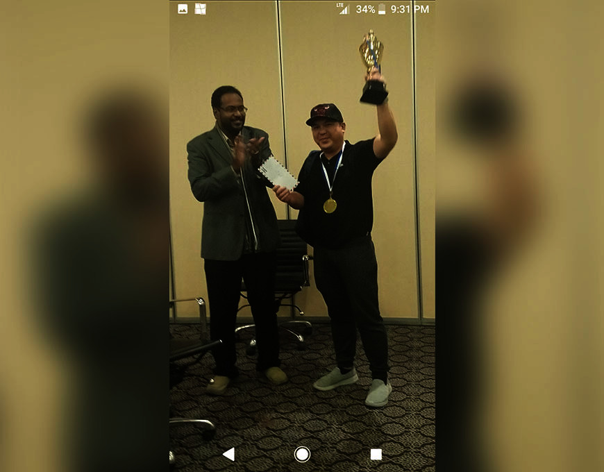 SAUDI ARABIA. National master (NM) Elwin Herbias Retanal raises his champion's trophy after topping the nd Resident Riyadh Rapid Chess Tournament title held at Mena Hotel Olaya, Riyadh, Kingdom of Saudi Arabia recently. (Contributed photo)