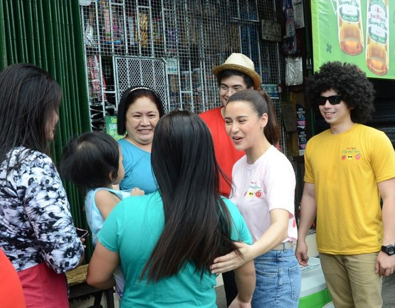 MANILA. Brand Ambassador Yassi Pressman with San Miguel Flavored Beer barkada Fro Bro and Geek Guy spent some #sweeeet time with fans when they toured sari-sari stores in Bagong Silang, Caloocan City recently. (Contributed Photo)