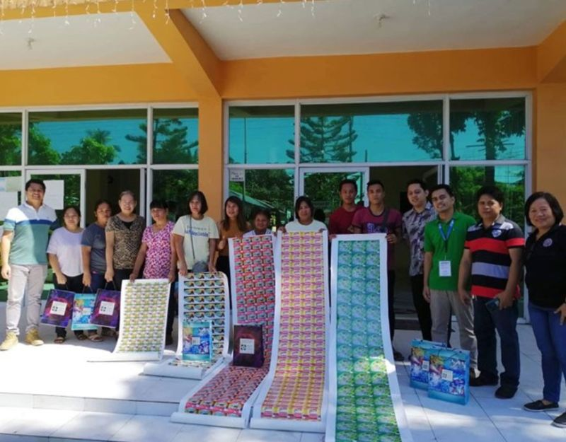 BACOLOD. Recipient-small and medium enterprises receive the packaging and labeling materials from personnel of the Department of Trade and Industry and Department of Science and Technology at town hall Thursday, December 26, 2019. (Contributed Photo)