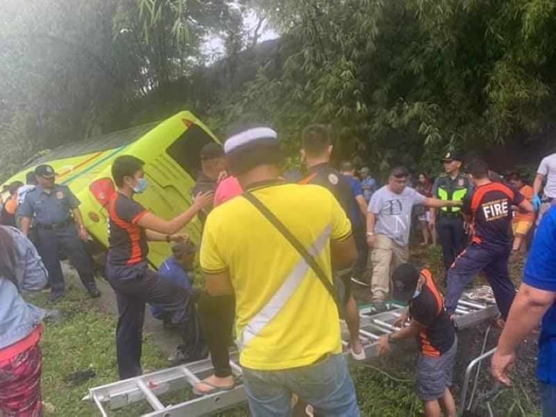 BACOLOD. A Ceres bus falls into a three-foot-deep canal along the highway of Bago City on Christmas Day. At least 22 people were injured. (Bago DRRMO photo)