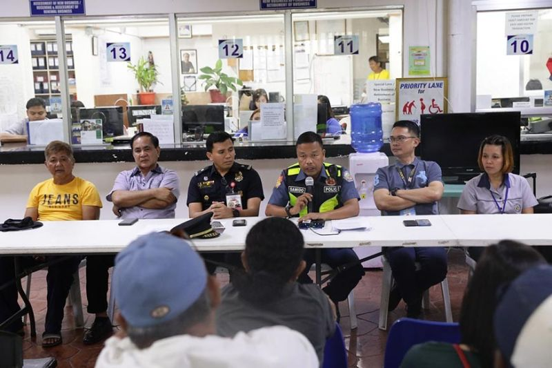 PAMPANGA. Police Lieutenant Colonel Paul Ynigo Gamido, San Fernando Chief of Police; Fire Chief Inspector Roderick Marquez, City Fire Marshal; Raymond Del Rosario, City Disaster Risk Reduction and Management Office (CDRRMO) Officer; Joseph Garcia, Business Permit and License Permit Officer, discuss the rules and regulations in the use of firecrackers and pyrotechnic devices with 35 legal firecracker vendors on December 27, 2019. (Contributed photo)