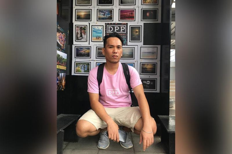 DAVAO. Glenn Magallano initiates in putting up booths to display his members' work to inspire them to take more photos. He poses at one of their booths at Matina Town Square. (Photo by Roberto A. Gumba Jr.)