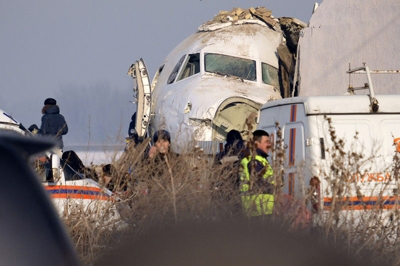 KAZAKHSTAN. Police stand guard as rescuers assist on the site of a plane crashed near Almaty International Airport, outside Almaty, Kazakhstan, Friday, December 27, 2019. The Kazakhstan plane with 98 people aboard crashed shortly after takeoff early Friday. (AP)