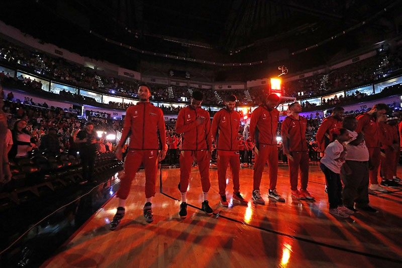 ATLANTA. The New Orleans Pelicans pause during a moment of silence for Carley McCord, a sports journalist who was the in-game host for the Pelicans and who died in a plane crash Saturday, December 28, 2019 before the team's NBA basketball game against the Indiana Pacers in New Orleans, Saturday. McCord, the daughter-in-law of LSU football offensive coordinator Steve Ensminger, had just departed Lafayette, La., en route to the Peach Bowl in Atlanta, where LSU was playing Oklahoma, when the plane crashed, killing five people. (AP)