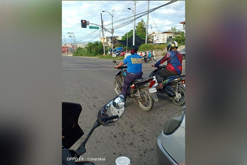 DAVAO. Netizen Mar Israel posted this photo of an auxiliary officer of the Davao City Police Office who was driving a motorcycle without a helmet in violation of the law. (Photo courtesy of Mar Israel)