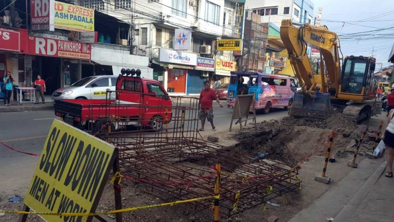 ROAD WORKS. Contractors of projects like these, which involve street diggings or installation of overhead or underground utility lines, will have to pay the Cebu City Government more for the application permit if the City Council approves the proposed fees. (SUNSTAR FILE)