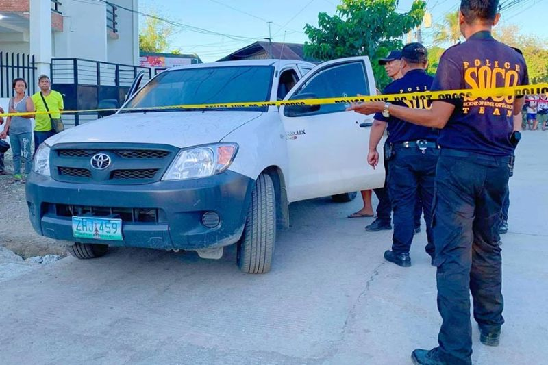 CRIME SCENE. A Scene of the Crime Operation team inspects the vehicle driven by Neil Boligao, who was shot dead as he was driving away from the abattoir in Talisay City early Monday morning, Dec. 30, 2019. (SunStar photo / Fe marie Dumaboc)