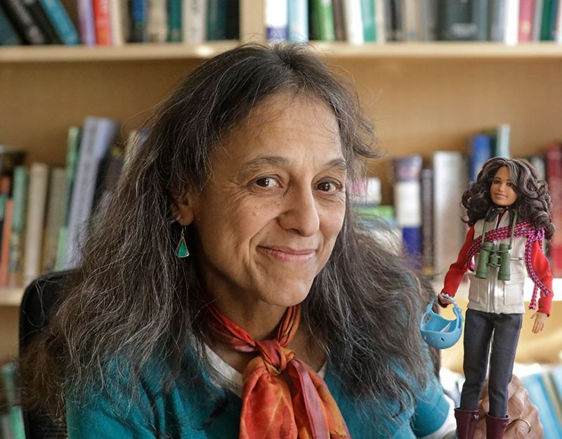 SALT LAKE CITY. This December 3, 2019, photo, ecologist Nalini Nadkarni is shown in her lab on the University of Utah campus in Salt Lake City holding a Barbie created to look like her when she's climbing into the treetops to study the rainforest canopy. Nadkarni's childhood climbing trees shaped her career and now she's hoping she can get help kids interested in science in a new way: Barbies. Nadkarni has long created her own
