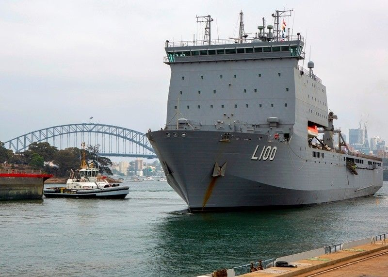 AUSTRALIA. In this photo provided by the Australian Department of Defense, HMAS Choules departs from a fleet base in Sydney, Wednesday, January 1, 2020. Australia is deploying military ships to help communities ravaged by wildfires that destroyed homes and sent thousands of residents and holidaymakers fleeing to the shoreline. (AP)