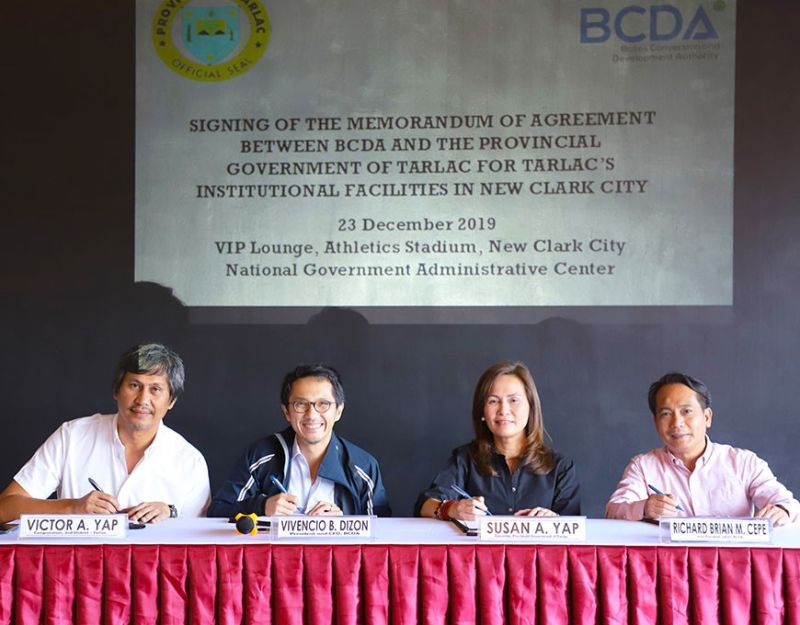 TARLAC. Representative Victor Yap, BCDA President and CEO Vince Dizon, Governor Susan Yap and BCDA vice president for Land and Assets Development Richard Brian Cepe during the signing of the agreement in line with the vision to make New Clark City an inclusive development. (Contributed photo)