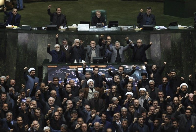 IRAN. Iranian lawmakers chant anti-American and anti-Israeli slogans to protest against the United States (US) killing of Iranian top general Qassem Soleimani, at the start of an open session of parliament in Tehran, Iran, Sunday, January 5, 2020. Soleimani's death Friday, January 3, in Iraq further heightens tensions between Tehran and Washington after months of trading attacks and threats that put the wider Middle East on edge. (AP)