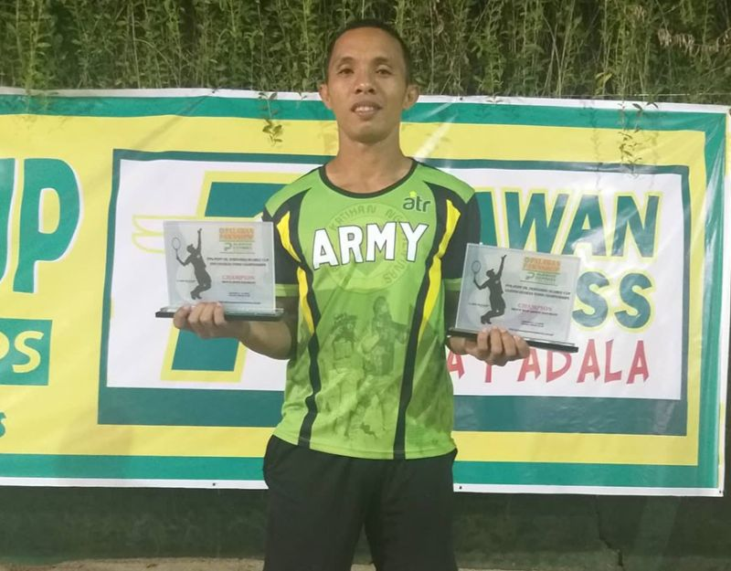 QUEZON CITY. Mark Anthony Alcoseba of Davao City holds his two championship trophies after pairing with two separate players in the recently-concluded PPS-PEPP Fr. Fernando Suarez Cup in Quezon City. (Contributed photo)