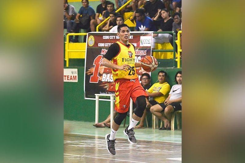 Cebuano basketball legend Dondon Hontiveros himself, will reinforce UC along with Talk N Text star Roger Pogoy. / Alex Tan