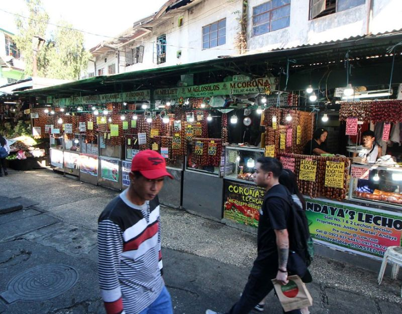 BAGUIO. Due for demolition? As city officials are keen on improving the city market, lechon and other vendors near the mini park are being eyed for relocation. (Photo by Jean Nicole Cortes)