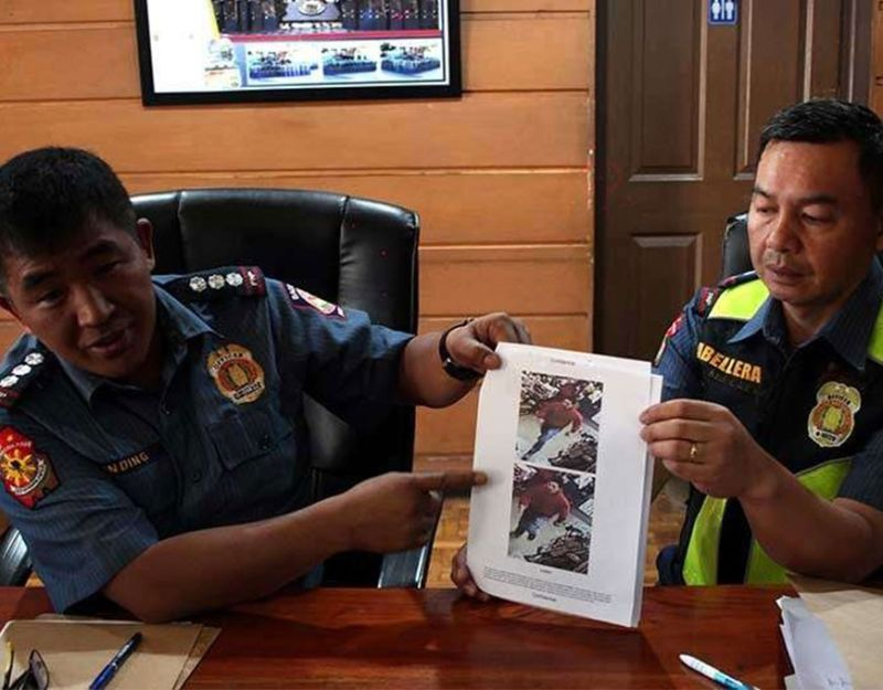 BAGUIO. In this December 6, 2019 file photo, Chief Superintendent Eliseo Tanding and Superintendent Yamson Abellera show photos grabbed from a camera footage showing a man who gunned down Imam Bedejim Abdullah, a Muslim leader and preacher at the Kayang Business Center at the Public Market in 2018. (Photo by Jean Nicole Cortes)