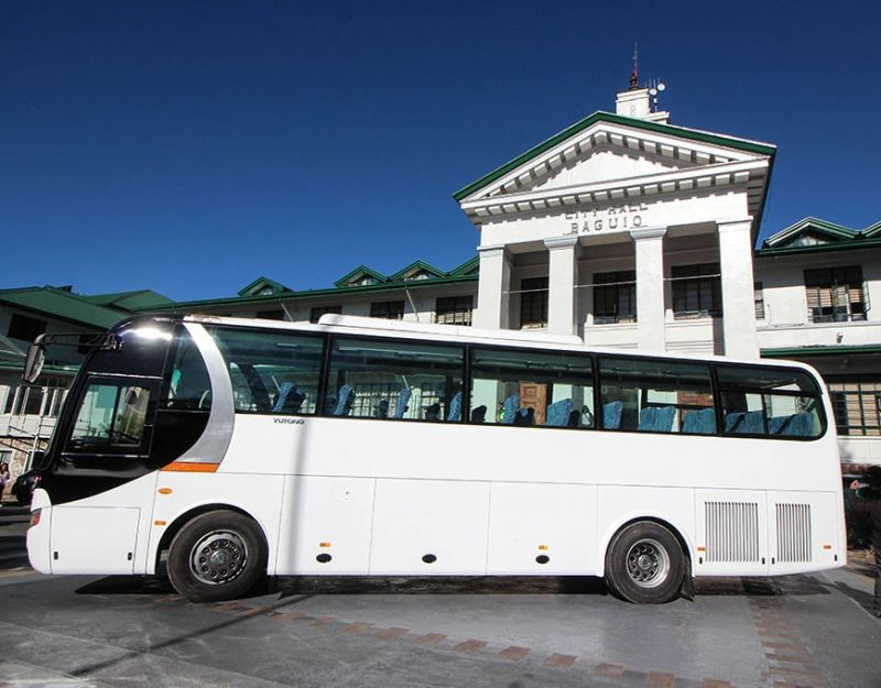 BAGUIO. The newly donated shuttle bus, courtesy of Solid North welcomes Baguio City Hall employees during their flag raising ceremony, Monday morning, January 6, 2020. This is the second bus donated to the city government since last year. (Photo by Jean Nicole Cortes)