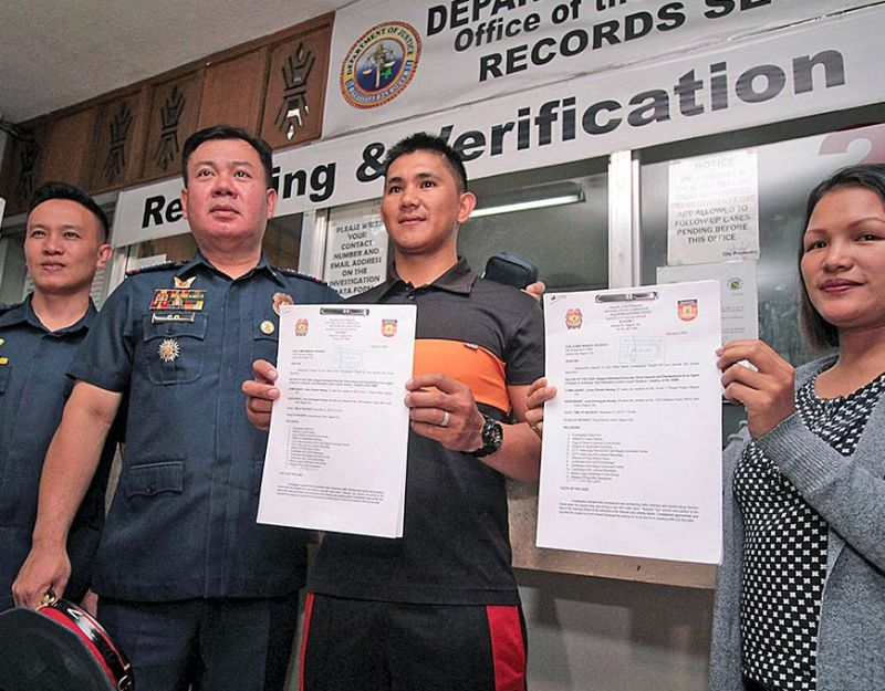 BAGUIO. Patrolman Julius Silvada Walang filed multiple cases before City Prosecutor Margarita Manalo, late Monday afternoon. With Walang is Baguio City Police Office city director Police Colonel Alen Rae Co, Police Staff Sergeant Sharon Pacyo, and Police Captain Ford Tuazon. (Photo by JJ Landingin)