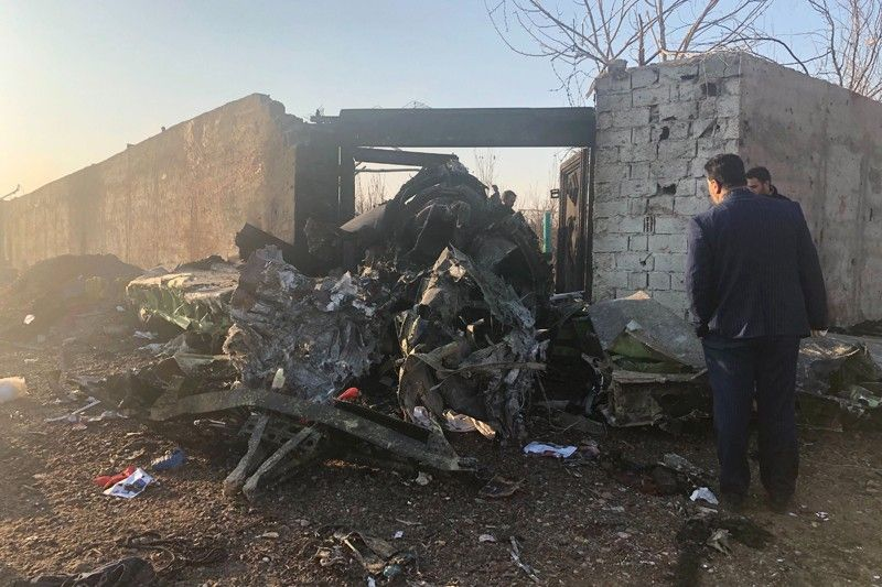 IRAN. Debris is seen from a plane crash on the outskirts of Tehran, Iran, Wednesday, January 8, 2020. A Ukrainian airplane carrying at least 170 people crashed on Wednesday shortly after takeoff from Tehran's main airport, killing all onboard, state TV reported. (AP)