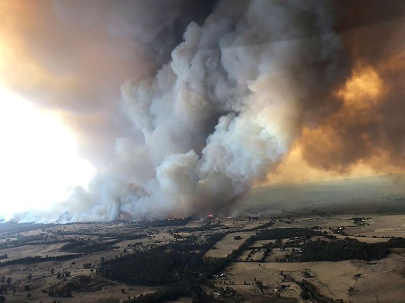 AUSTRALIA. In this Monday, December 30, 2019, aerial photo, wildfires rage under plumes of smoke in Bairnsdale, Australia. (AP)