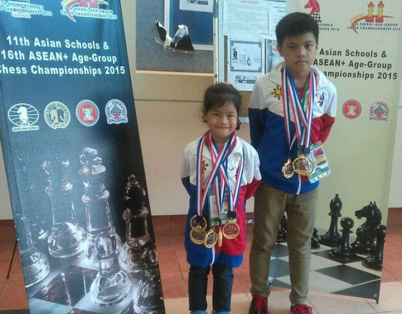 CAGAYAN DE ORO. The Canino siblings, Ruelle and Ronald, during one of their age-group chess exploits abroad. (Contributed photo)
