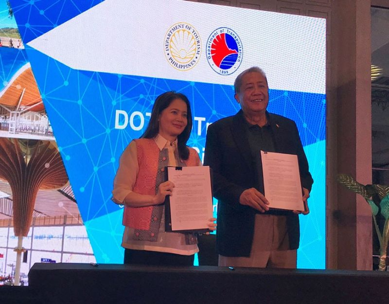 PAMPANGA. The Department of Tourism, represented by Secretary Bernadette Romulo-Puyat (left), and Department of Transportation, represented by Secretary Arthur Tugade (right), sign a memorandum of agreement for the implementation of the Institutionalized Leveraging of Infrastructure Program for Airport Development otherwise known as iLipad. (PIA)