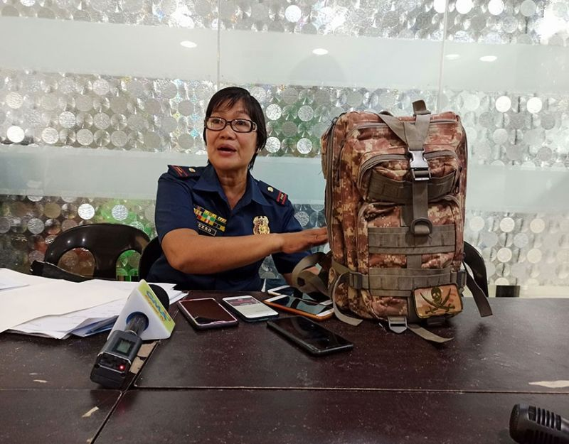 ILOILO. Police Lieutenant Mercylin Duero of the Iloilo City Police Office during a press conference shows that backpacks are prohibited in the activity area where Dinagyang tribes will perform. (Leo Solinap)