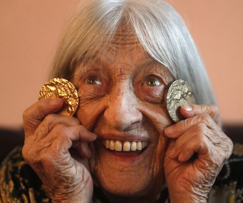 Agnes Keleti, former Olympic gold medal winning gymnast, poses for a photo with two of her Olympic medals at her apartment in Budapest, Hungary Wednesday January 8, 2020. Although she turned 99 on Thursday, even a 9-year-old would have a hard time keeping up with Agnes Keleti's irrepressible energy and enthusiasm. Keleti is the oldest living Olympic champion and a Holocaust survivor. She won 10 medals in gymnastics — including five golds — at the 1952 Helsinki Games and at the 1956 Melbourne Games. (AP)