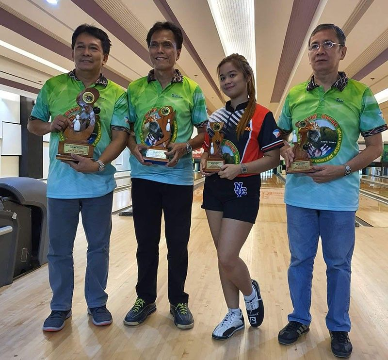 DAVAO. Champion Sammy Talaboc, runner-up William Galacio, third placer Ma. Vivienne Flores and fourth placer Rene Zabat pose with their trophies at the close of the Metro Davao Bowlers Association, Inc. (Metba-Davao) Bowler of the Year 2019 title Friday, January 10, at SM Lanang Premier Bowling Center. (Contributed photo)