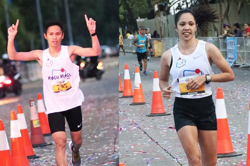 COUPLE GOALS. Elite runners Ruffa Sorongon and Azlan Pagay, who have been in a relationship for six years, topped the men's and women's division of the Cebu Marathon. It was the fourth time the two swept the men's and women's divisions in a race. (Sunstar Photo / Amper Campaña)