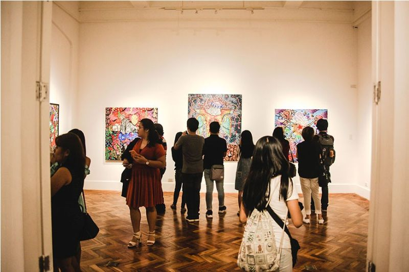 Guests taking glance of the exhibit during the opening. (Contributed photo)