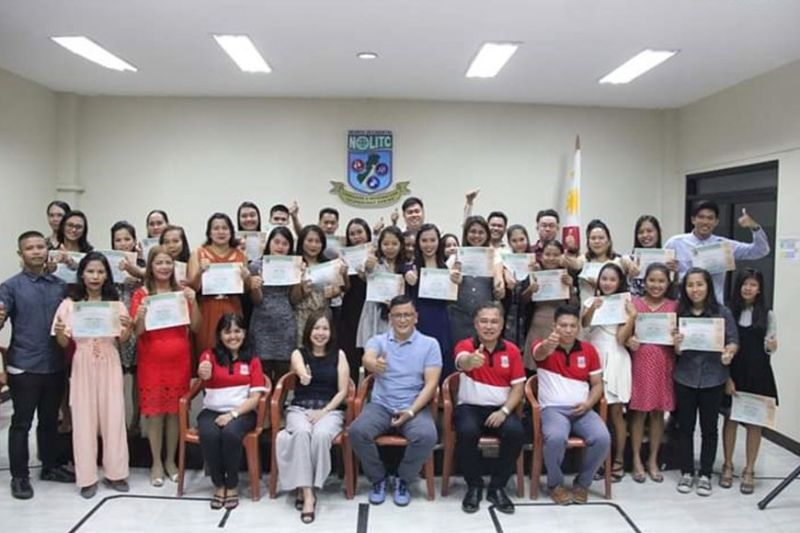 BACOLOD. The 51 graduates of Contact Center Services National Certificate II Course with Nolitc personnel headed by Vocational School Administrator Ma. Cristina Orbecido (seated left), Fifth District Board Member Ernesto Bascon (seated center) and Executive Assistant Charina Magallanes-Tan (seated second from left) during their graduation rites at the provincial government-run center in Bacolod City Monday, January 13, 2020. (Capitol PIO Photo)
