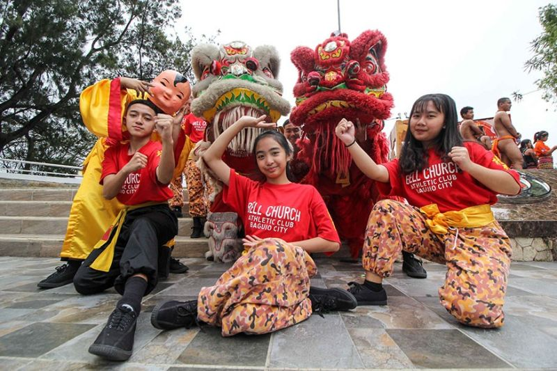 BAGUIO. Young performers from Bell Church Athletic club pose for pictures after the launching of Spring Festival 2020 at the Baguio City Hall grounds Monday morning. The Year of the Rat starts January 25 which marks the beginning of Chinese New Year. (Photo by Jean Nicole Cortes)