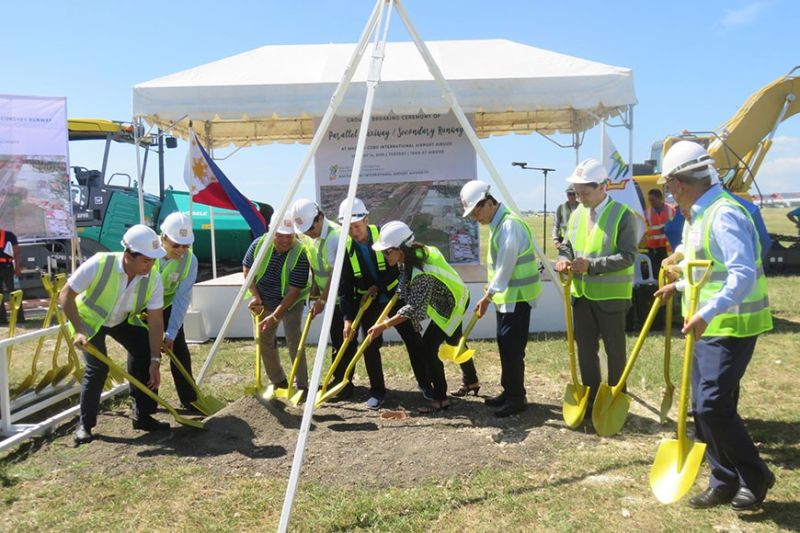 CEBU. The construction of the parallel taxiway or secondary runway at the airside of the Mactan-Cebu International Airport (MCIA) is afoot. Among those who shoveled to lay the time capsule into the ground on Tuesday, January 14, 2020 are MCIA Authority general manager Steve Dicdican, Department of Tourism (DOT)-Central Visayas Director Shahlimar Hofer Tamano, MCIAA director Julius Neri Jr., Lapu-Lapu City Mayor Junard Chan, Cebu City Representative Raul del Mar and Rafaelito Barino of the project contractor Duros Group of Companies. (Allan Cuizon)