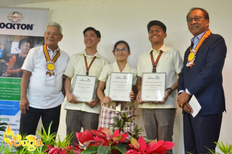 "CEBU. With their research ""Women Empowerment, Waste Management and Livelihood Building Capacity of the Community through Vermicomposting,"" Cebu Normal University (CNU) students Deann Martin T. Durano,  Tyra Lee L. Ibale and Renz John Espinosa (center, starting from the second person from left) receive the second prize in the first-ever Lockton Legacy Awards at the CNU campus in Cebu City on January 7, 2020. The students are flanked by Lockton Philippines chief executive officer and president Victorio Valledor (rightmost) and chief operating officer and vice president Manuel Quijano (leftmost). (Contributed photo)"