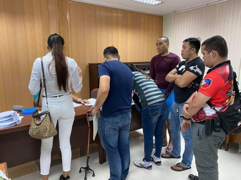 "HEARTBREAK WARFARE. Basketball player Eliud ""Eloy"" Poligrates (in maroon shirt) stares at his former girlfrend (in polo shirt) as the personnel of the Abellana Police Station prepare the complaints against him at the Cebu City Prosecutor's Office on Wednesday, Jan. 15, 2020. Poligrates allegedly assaulted his ex-girlfriend during a meeting last Tuesday, Jan. 14. (Sunstar Photo / Benjie Talisic )"