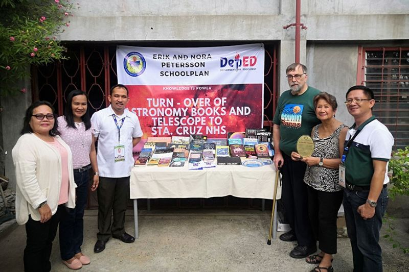 TURNOVER. The Erik and Nora Petersson School Plan (ENPS) Foundation has turned over astronomy books and telescopes to Sta. Cruz National High School in Talicud Island, Samal on January 6, at ENPS Office, Lanzona Subdivision, Matina, Davao City. (From left) Mercedes G. Caberos, Principal of Sta Cruz National High School; Jasmin Neri, the Department of Education –Samal Division Partnership Focal Person; Winnie E. Batoon, assistant Schools Division Superintendent officer in charge, office of the schools division Superintendent; ENPS Foundation founder Erik Petersson; Nora Petersson; and Allan D. Balisbis, Division EPS- Science. (Ace June Rell Perez)