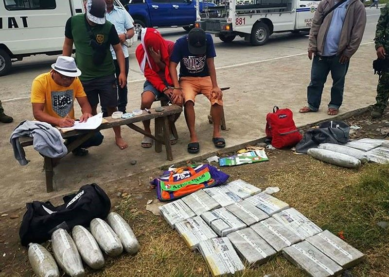 NABBED. Anti–narcotic agents and other law enforcement agencies inventory the several dried marijuana bricks confiscated from two tourists in Tabuk City, Kalinga on Monday. (Contributed photo)