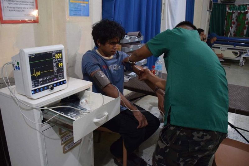 ZAMBOANGA. A military physician checks the health condition of Muhammad Farhan, 27, an Indonesian fishermen, whom the troops rescued on Wednesday, January 15, from captivity by the Abu Sayyaf bandits in Indanan, Sulu. (Contributed photo)