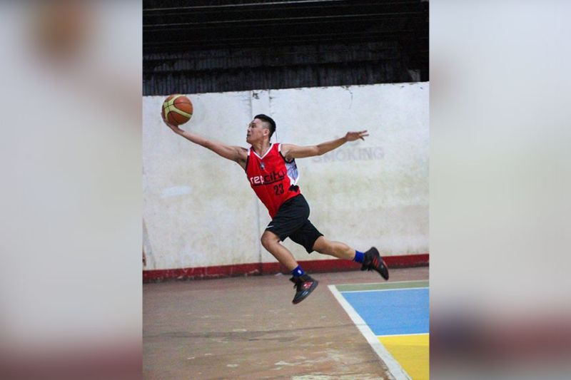 HE CAN FLY. A player from Rep City jumps to keep the ball from going out of bounds. (Contributed photo)