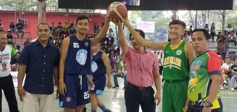 Host Tagoloan Mayor Gomer Sabio leads the ceremonial tip-off alongside NBTC-Mindanao Territory Head Arvin Martinez and Misamis Oriental Commissioner Archie Ello on Thursday's opening, January 16, 2020 of the first ever Chooks-To-Go NBTC qualifier at the Tagoloan Dome of Misamis Oriental. (Lynde Salgados)