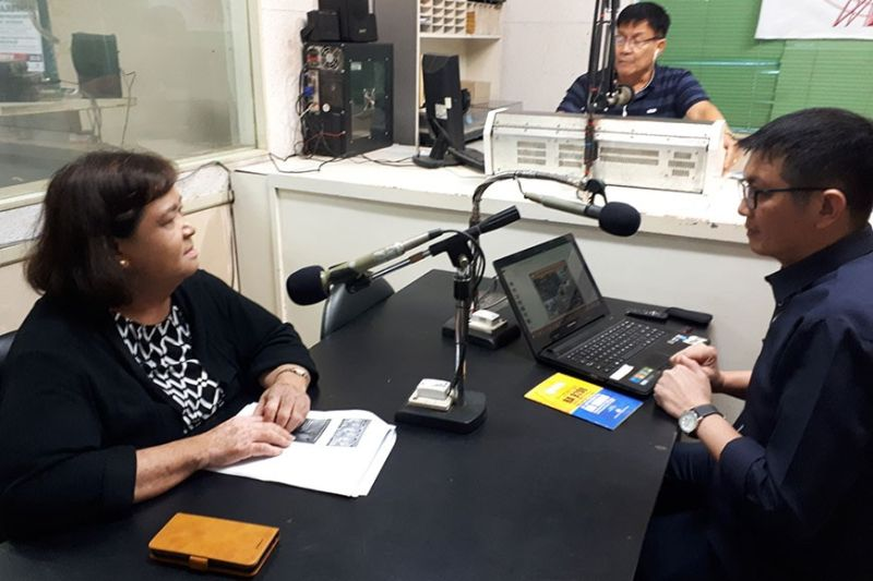 BACOLOD CITY. Allan Ducusin, right, of the Commission on Filipino Overseas (CFO) urges Negrenses to go abroad legally by consulting local Public Employment Service Office (Peso) and the Philippine Overseas Employment Administration (POEA) office during an interview over DYRL. At left, is Maya Sanches also of CFO. (Contributed photo)