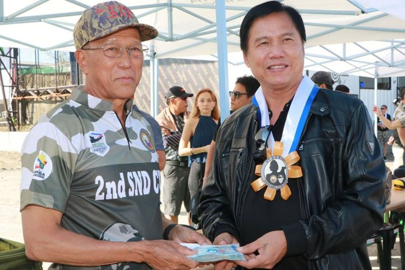 PAMPANGA. Defense Secretary Delfin Lorenzana receives a donation from San Simon Mayor Jun Punsalan during Friday's (January 17) opening ceremony of the 2nd SND Cup Shoot for a Cause. (Chris Navarro)
