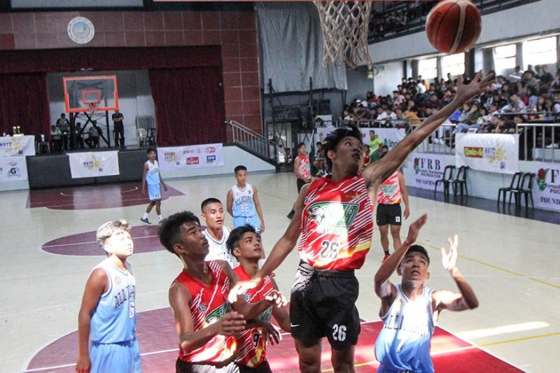 BAGUIO CITY. Allan Jay Calabaguib of North Eastern College from Santiago City banks an easy lay-up against Allacapan Vocational High School from Cagayan during the elimination round of the SM NBTC League at the University of Baguio gym last week. (Jean Nicole Cortes)