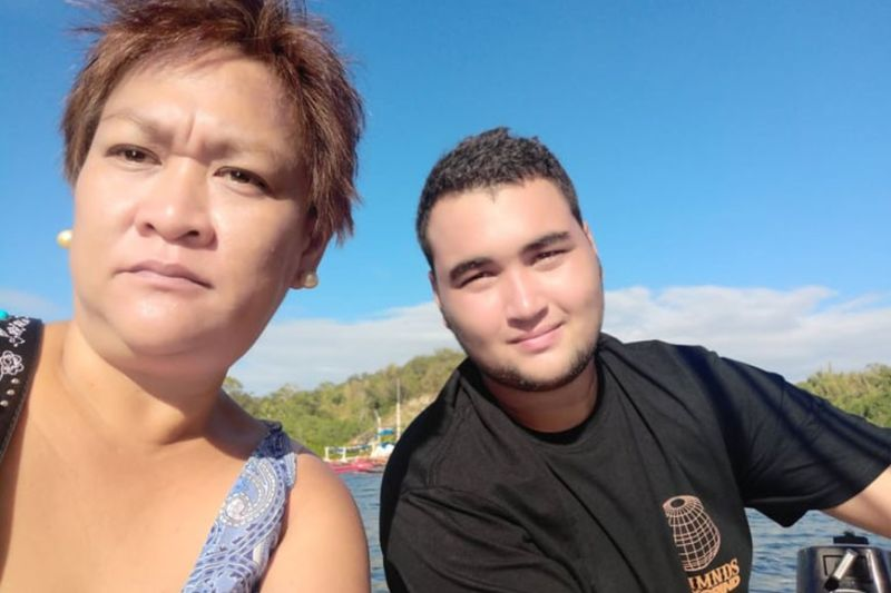 NEGROS ORIENTAL. Michelle Gasataya Purvis with her son Casey on a dinghy heading to their yacht.(Photo by Churchill Aguilar)