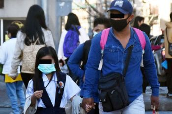 BAGUIO. Aside from serving as protection from the Taal Volcano ash fall scare, Baguio folks regularly use face masks due to the worsening pollution in the city and to avoid the spread of diseases. (Redjie Melvic Cawis)