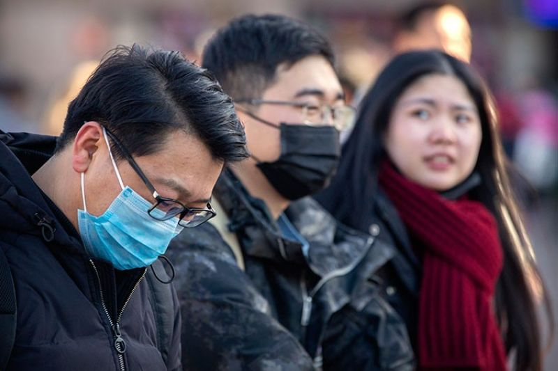 CHINA. Travelers wear face masks as they walk outside of the Beijing Railway Station in Beijing, Monday, January 20, 2020. China reported Monday a sharp rise in the number of people infected with a new coronavirus, including the first cases in the capital. (AP)
